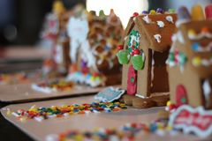 Gingerbread Houses candy decorated in a row multiple houses stock image