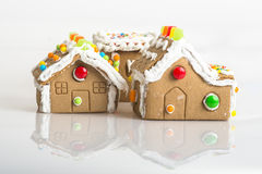 Gingerbread houses. Hand made gingerbread houses on white background Stock Photo