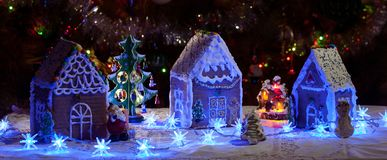 Gingerbread houses under the Christmas tree. Christmas decor royalty free stock photo