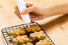 Gingerbread with icing decorating process Stock Photo