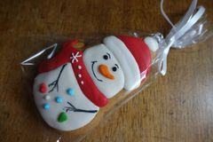 Gingerbread with icing in form of snowman stock photo