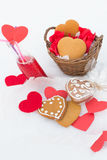 Gingerbread and lemonade with paper hearts on the snow. Gingerbread and cranberry lemonade with paper hearts on the snow Stock Images