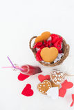 Gingerbread and lemonade with paper hearts on the snow. Gingerbread and cranberry lemonade with paper hearts on the snow Stock Photos