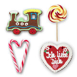 Gingerbread locomotive lollypop candy canes gingerbread heart on white background Royalty Free Stock Image