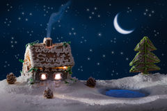 Gingerbread lodge with light from the window stock photography