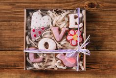 Gingerbread love saddle flower bird bird gift packing colored sw. Colorful Sweets Gingerbread Love Heart Bird Flower In Gift Box With Ribbon holiday cookies Royalty Free Stock Image