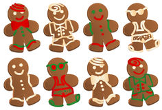 Gingerbread Man. Set of eight gingerbread men cookies in four styles, each style decorated in color and plain frosting.  Four styles are Swim Dude, Bowtie Dude Stock Photography