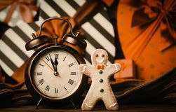 Gingerbread man and alarm clock with gifts stock photo