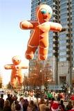 Gingerbread Man Balloons Float Through Atlanta Christmas Parade. Atlanta, GA, USA - December 1, 2012: Two inflated gingerbread man balloons move through the stock photo