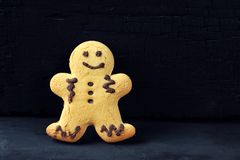 Gingerbread man on a black background royalty free stock photo