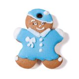Gingerbread man in a blue coat and hat isolated Stock Photography