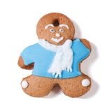 Gingerbread man in a blue coat and scarf isolated Stock Photos
