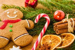 Gingerbread man with a candy cane Stock Photo