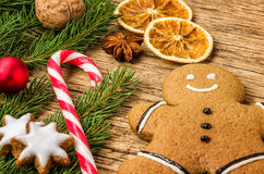 Gingerbread man with a candy cane and christmas decorations Stock Photography