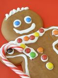 Gingerbread man with candy cane Royalty Free Stock Images