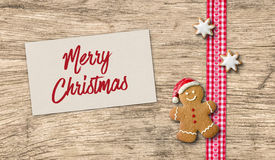 Gingerbread man with Christmas card Stock Photo