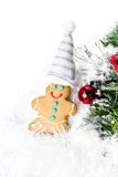 Gingerbread Man Christmas Cookie and Christmas decorations on  w Stock Photos