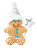 Gingerbread Man Christmas Cookie with Santa hat and magic stick Royalty Free Stock Photo