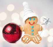 Gingerbread Man Christmas Cookie with Santa hat, magic stick and Royalty Free Stock Photography