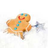 Gingerbread Man Christmas Cookie in a snow on white background, Stock Image