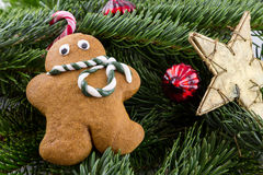 A gingerbread man with Christmas decorations Royalty Free Stock Image
