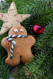 A gingerbread man with Christmas decorations Stock Image