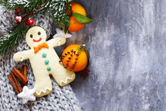 Gingerbread man and Christmas decorations Stock Photos