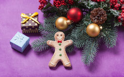 Gingerbread man and christmas gifts Stock Image