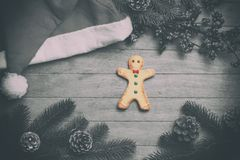 Gingerbread man and christmas hat Royalty Free Stock Photography