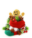 Gingerbread man and Christmas spices in knitting socks Royalty Free Stock Photo