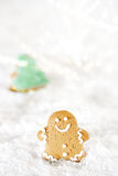 Gingerbread man and christmas tree on a festive Christmas snow Royalty Free Stock Images