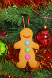 Gingerbread man on a Christmas tree Stock Photos