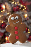 Gingerbread man close up christmas tree in background Stock Photos