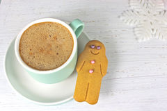 Gingerbread man and coffee Christmas snack on rustic background Stock Images