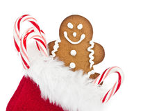 Gingerbread man cookie and candy canes Stock Images