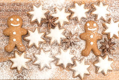 Gingerbread man cookie, cinnamon stars and star anise Stock Photography