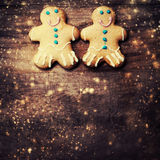 Gingerbread man cookie with copyspace and festive glitter Royalty Free Stock Images