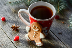 Gingerbread man cookie and cup of tea Royalty Free Stock Images