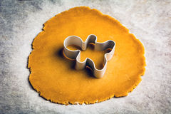 Gingerbread man cookie cutter on cookie dough Royalty Free Stock Images