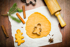Gingerbread man cookie cutter on cookie dough Royalty Free Stock Photo