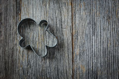 Gingerbread Man Cookie Cutter on Rustic Wood Royalty Free Stock Images