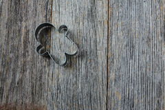 Gingerbread Man Cookie Cutter on Rustic Wood Royalty Free Stock Image