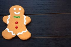 Gingerbread man cookie on left with blank space royalty free stock photography