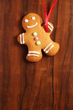 Gingerbread man cookie over brown wooden texture Royalty Free Stock Images