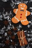 Gingerbread man cookie with star anise and cinnamon sticks and snow royalty free stock photos