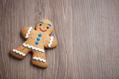 Gingerbread man cookie on wooden table Royalty Free Stock Images