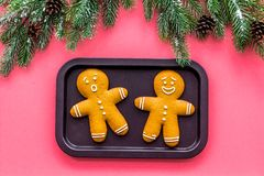 Gingerbread man cookies for New Year meal near spruce branch on white background top view Stock Photos