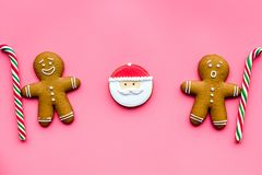 Gingerbread man cookies for New Year meal on pink background top view Royalty Free Stock Photo
