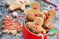 Gingerbread man cookies in red cup, festive treats and sweet gif Stock Photos