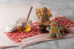 Gingerbread man cookies on red rural napkin Royalty Free Stock Images